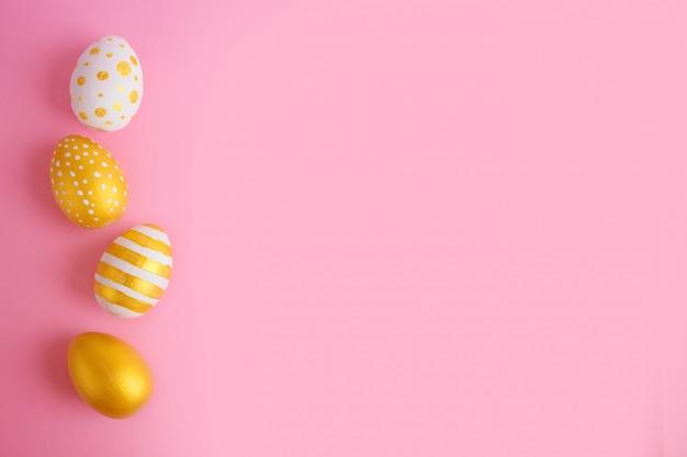 Ovos de páscoa dourados e brancos