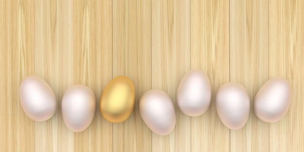 Ovos de páscoa madrepérola e um ovo de ouro