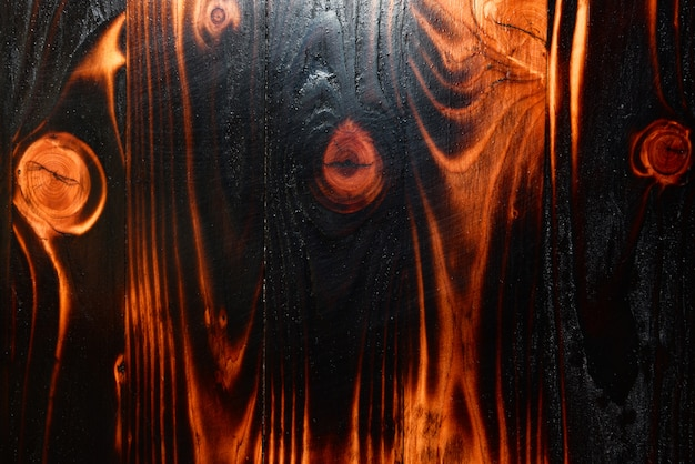 Padrão abstrato textura de madeira escura, madeira de pinho queimar