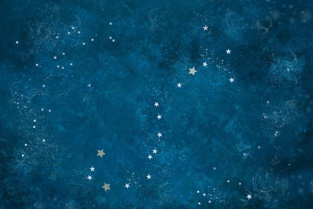 Padrão astronômico celestial constelação de escorpião de confete prateado em forma de estrela no fundo azul
