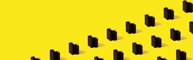 Padrão com venda de sacolas de compras pretas em formato de banner de fundo amarelo com espaço de cópia