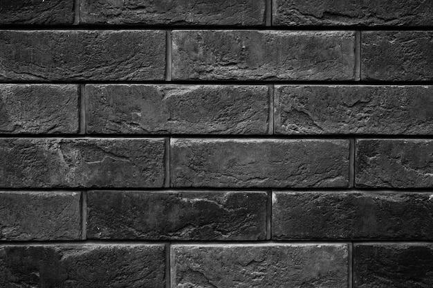 Padrão da superfície da parede de pedra ardósia preta decorativa como pano de fundo