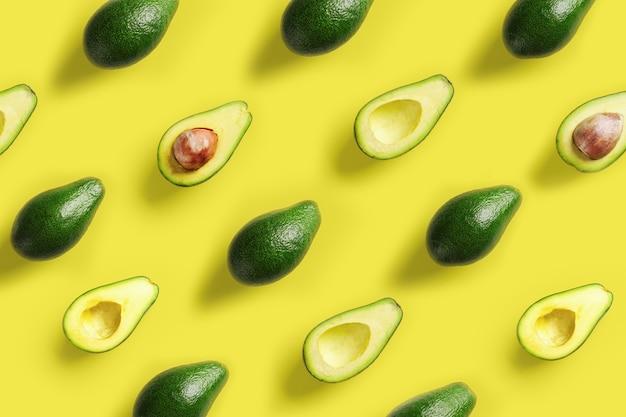 Padrão de abacate em fundo amarelo. projeto da arte pop, conceito criativo de comida de verão.