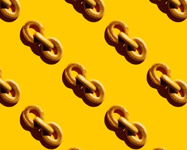 Padrão de bagel em fundo amarelo