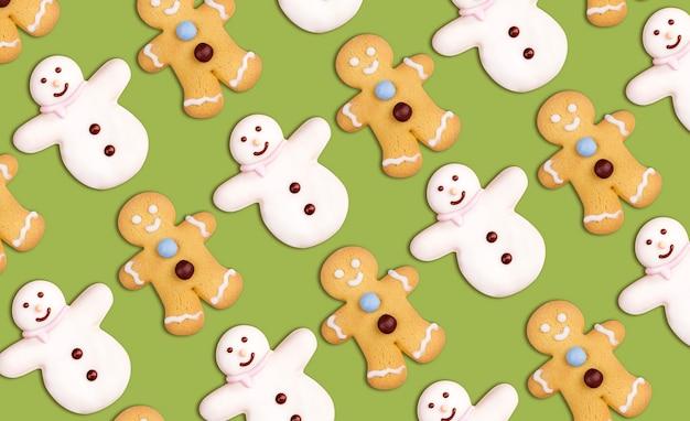 Padrão de biscoitos de natal de boneco de neve e boneco de gengibre decorado