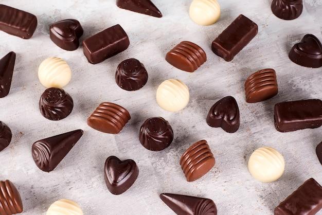 Padrão de coleção de fotos sortido de bombons de chocolate
