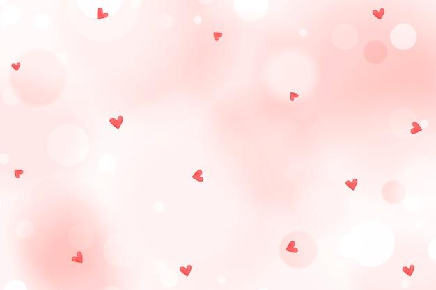Padrão de confete de coração em um fundo rosa crepe Foto Premium