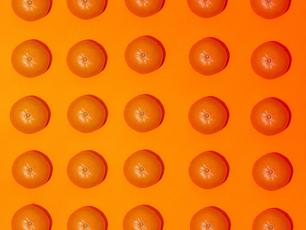 Padrão de fruta colorida de tangerinas frescas