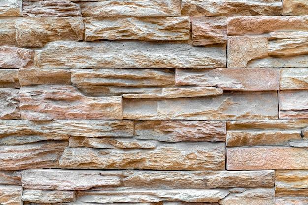 Padrão de fundo de textura de parede de pedra empilhada ou parede de tijolo