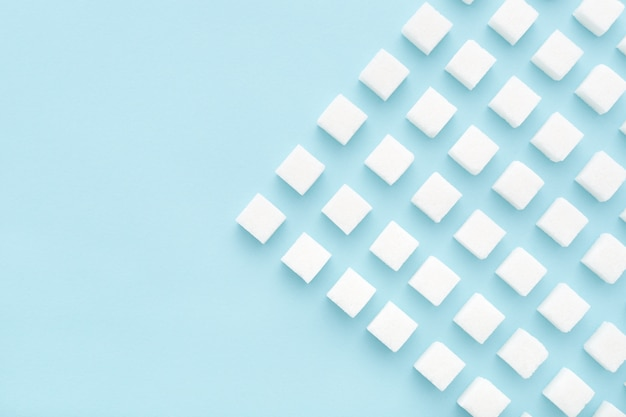Padrão de geometria de cubos de açúcar em azul claro.