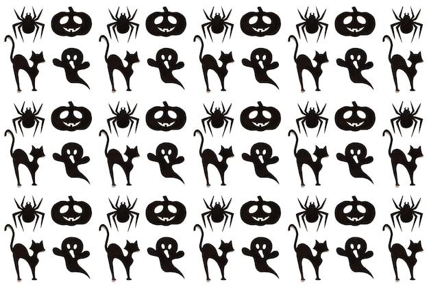 Padrão de halloween. coleção preta dos desenhos animados sobre fundo branco. arte em papel. conceito de férias feliz hallowen.