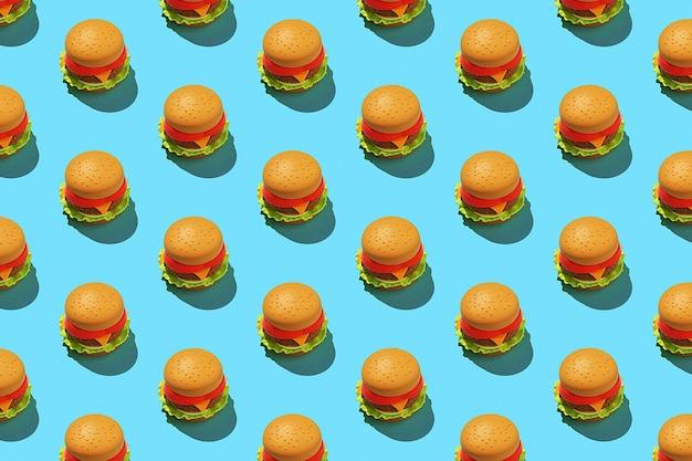 Padrão de hambúrguer minimalista sobre fundo azul.