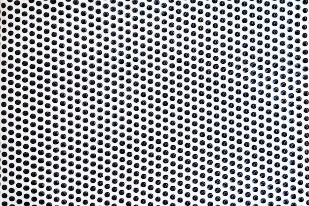 Padrão de linhas de pontos pretos na superfície branca como plano de fundo