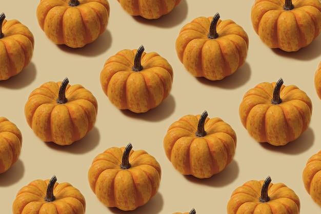 Padrão de outono na cor amarela e laranja. fundo mínimo de mini abóboras de halloween. layout criativo.