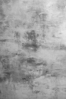 Padrão de parede cinza texturizado com gesso para o projeto. fundo cinzento com copyspace.