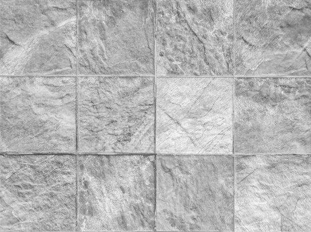 Padrão de superfície tijolo closeup no fundo da parede de tijolo de pedra texturizada em tom preto e branco