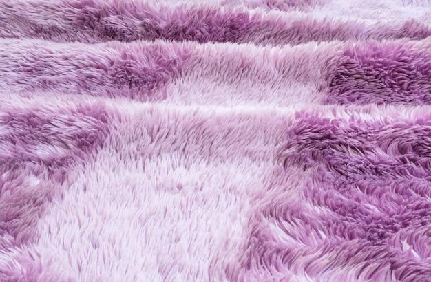 Padrão de tecido abstrato closeup superfície no tapete roxo no fundo de textura de piso