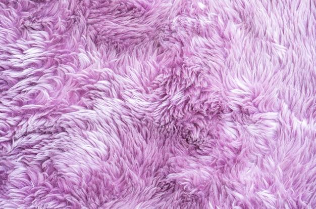Padrão de tecido abstrato de superfície closeup no tapete de tecido roxo no chão da casa textura de fundo