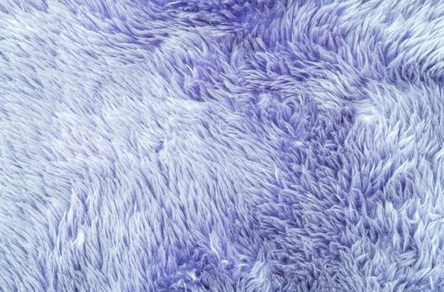 Padrão de tecido abstrato de superfície closeup no tapete de tecido roxo