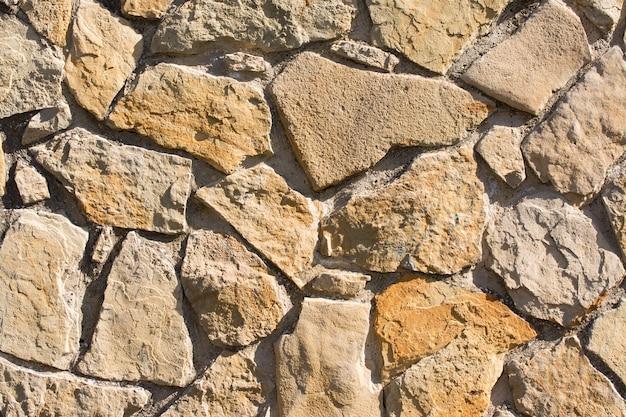 Padrão de textura de parede de pedras lascadas e