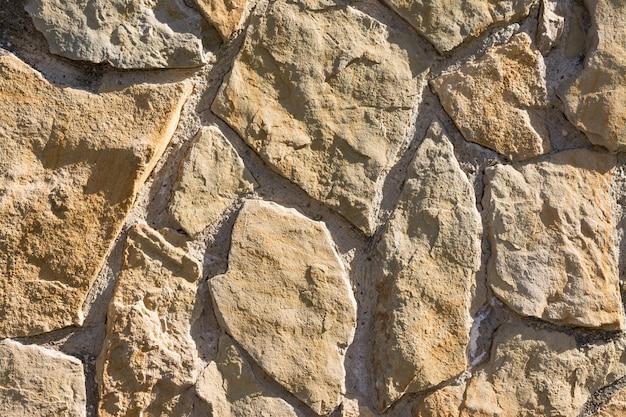 Padrão de textura e fundo de parede de pedras lascadas