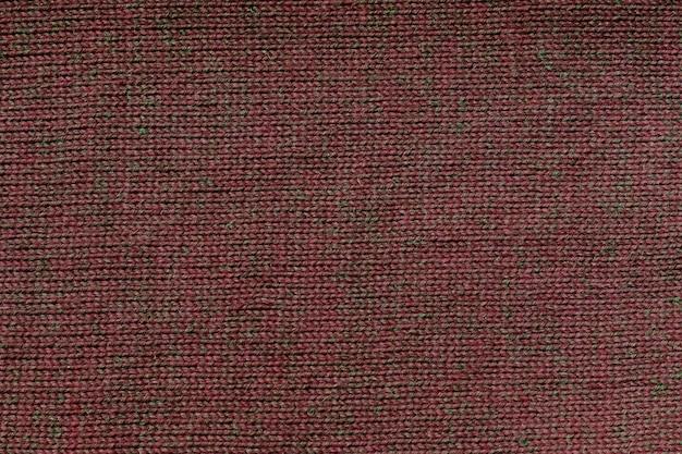 Padrão de tricô de malha marrom, plano de fundo.