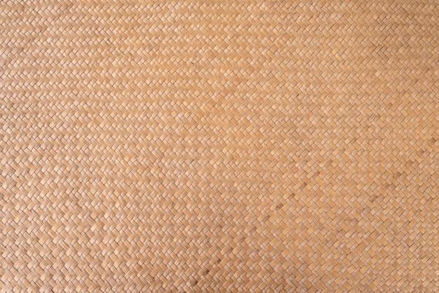 Padrão de vime seco tailandês chamado krajood em tom marrom.