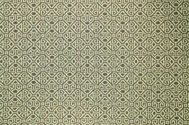 Padrão do painel de papel de parede de roupas de tradição verde, close-up
