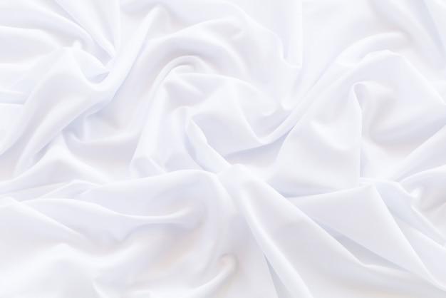 Padrão e detalhe sulcado de tecido branco para plano de fundo e abstrato