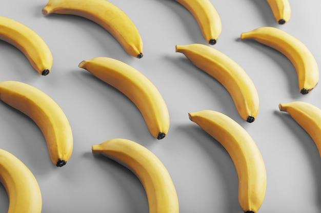 Padrão geométrico de bananas amarelas em cinza