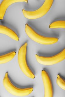 Padrão geométrico de bananas amarelas em um fundo cinza nas cores da moda de 2021