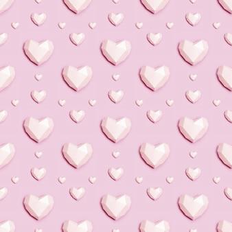 Padrão sem emenda com coração de papel poligonal rosa em fundo rosa.
