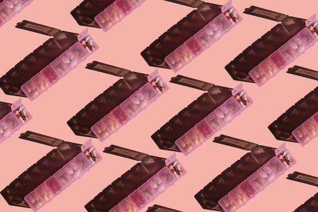 Padrão sem emenda de caixas de comprimidos em fundo rosa
