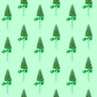 Padrão sem emenda de natal e ano novo com pirulitos em forma de árvore de natal