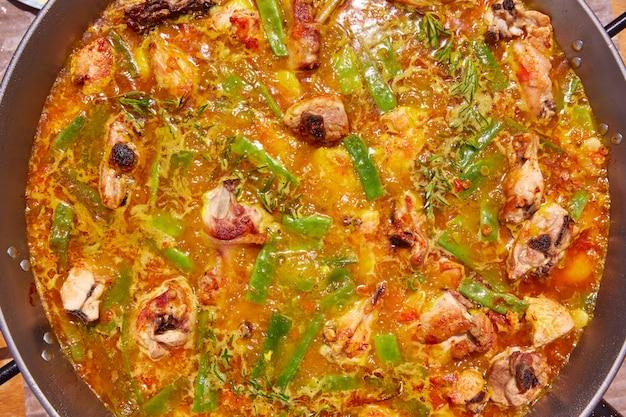 Paella from spain recipe process caldo fervente