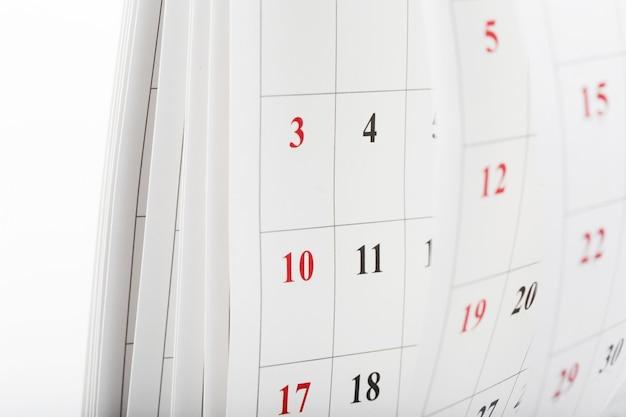 Páginas de calendário fecham o conceito de tempo de negócios