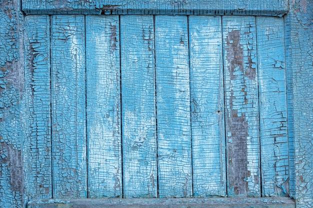 Painéis de madeira antigos. painéis de madeira pintados verdes horizontais close-up.