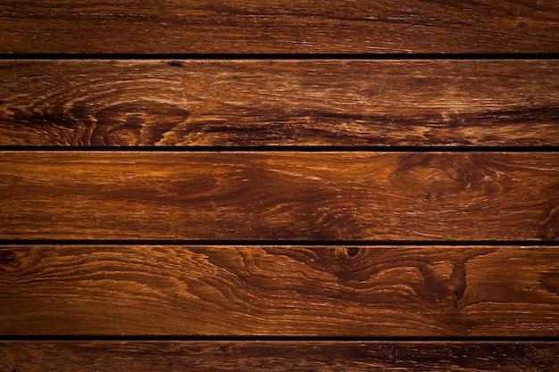 Painéis velhos da textura horizontal marrom do fundo da parede de madeira da prancha.