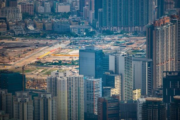 Paisagem da cidade do porto de victoria de hong kong, centro comercial urbano com torre de construção do horizonte, cena do distrito da ásia com vista da arquitetura de arranha-céus para viajar