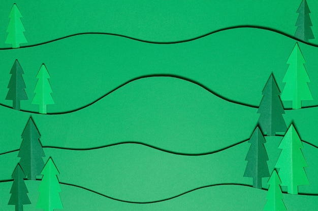 Paisagem de árvores florestais em estilo de corte de papel. fundo de papel artesanal