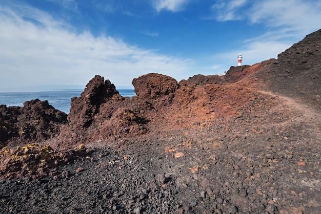 Paisagem vulcânica de tenerife e farol ao fundo, teno, tenerife, canlan islan