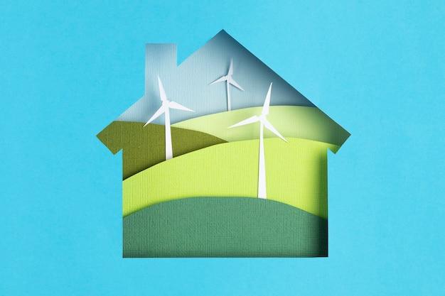 Paisagens de turbinas de vento em casa de corte de papel conceito ecológico de papercraft