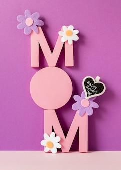 Palavra da mãe com arranjo de flores