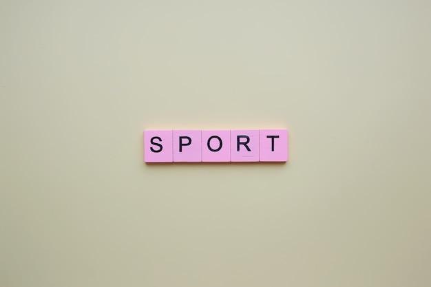 Palavra de esporte em um fundo amarelo.