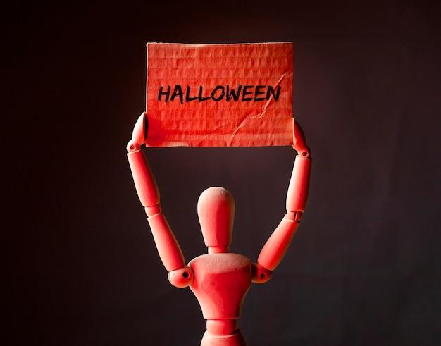 Palavra de halloween no cartaz em luz vermelha, feriado de outubro