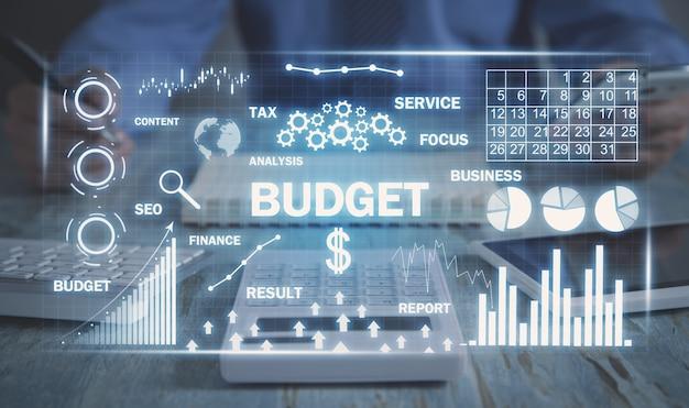 Palavra de orçamento com setas e gráficos. o negócio