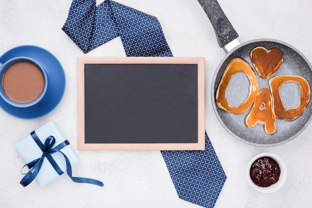 Palavra de pai escrita em pães e gravata
