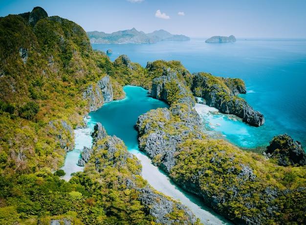 Palawan, filipinas vista aérea do drone da lagoa turquesa e penhascos de calcário. el nido marine
