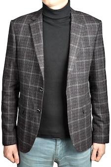Paletó de lã na célula em combinação com jeans, imagem isolada no fundo branco.