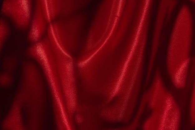 Pano brilhante de cor vermelha. pano brilhante de cor vermelha, fundo romântico de luxo, tecido
